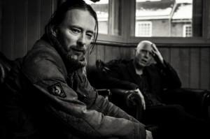 Thom-Yorke-Stanley-Donwood-Sitting-BW-Michael-Muller-x1000-678x451